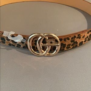 "Leopard suede belt. ""CG"" on the buckle."